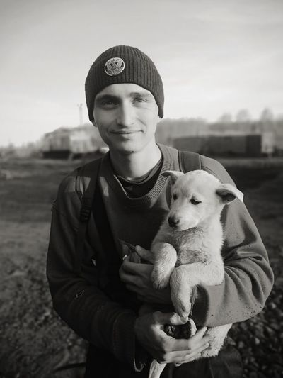 Portrait of smiling man with dog