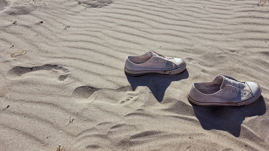 Live For The Story Sand Beach Shore Pair Day High Angle View Nature Outdoors No People Vacations Close-up Footsteps In The Sand Footsteps Summer Soccer Shoe