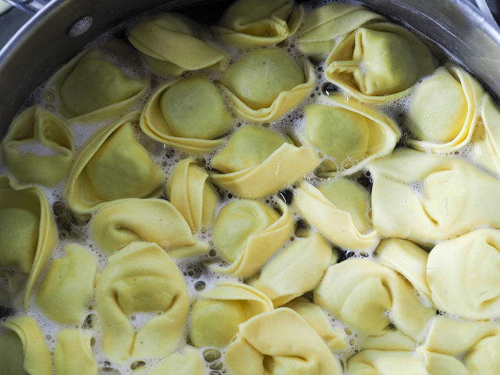 Bolinig and cooking home made spinach and ricotta cheese tortellini italian stuffed pasta at home Cooking At Home Close-up Food Food And Drink Freshness Healthy Eating Indoors  Italian Food No People Pasta Stuffed Pasta Tortelli Tortellini  Wellbeing
