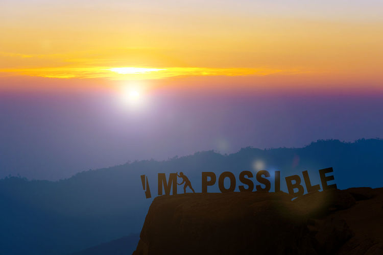 Sunset Sky Text Mountain Western Script Communication Scenics - Nature Beauty In Nature Sun Nature Cloud - Sky Tranquility Tranquil Scene Idyllic Mountain Range Orange Color Non-urban Scene No People Sign Sunlight Message Mountain Peak Impossible Moments Possible Man Push