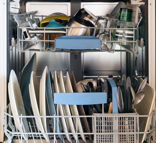 Close-up of utensils in rack