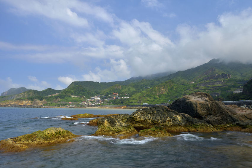 The northeast corner of Taiwan's New Taipei City is a scenic spot suitable for sightseeing. Jinguashih Northeast Coast Taiwan Beach Beauty In Nature Cloud - Sky Coastline Day Land Motion Mountain Nature New Taipei City No People Outdoors Pollution Rock Rock - Object Scenics - Nature Sea Sky Solid Tranquil Scene Tranquility Water