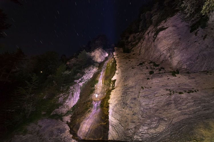 Scenic view of rock formations at night