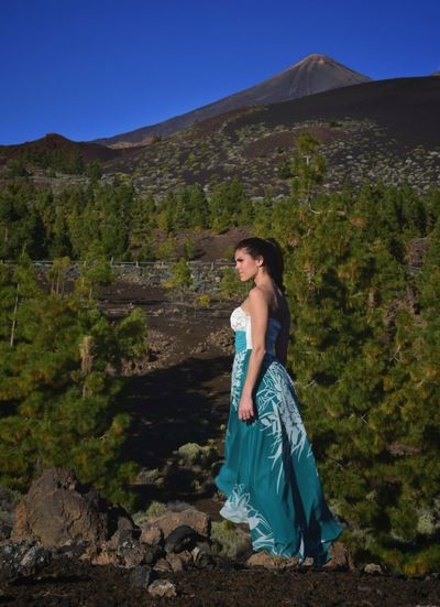 Woman looking away while standing at el teide national park