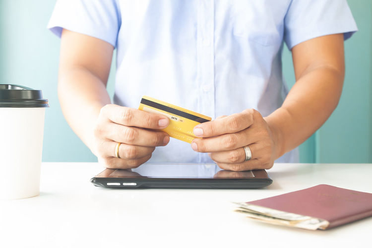 Man hand holding plastic credit card. E-payment, business and online payment Hotel Trip Passport Cart Traveler Plastic Concept Entering E-commerce Cvv Ordering Wireless Tax Male Order Debit Smart Security Man Typing RISK Information Data Lifestyle White Phone Ecommerce Keyboard Notebook Finance Electronic Internet Store Home Buy Technology Commerce Banking Using Purchase Business Pay Computer Shopping Laptop Holding Payment Online  Card Credit