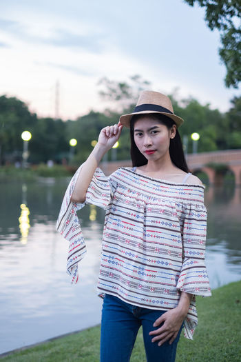 asian woman tourists. he is posing for a model fashion concept. in the park and tourist attractions. happily during travel the holidays and relax. Smile Woman Travel Asian  Landmark Picture Female Background Portrait Young Adult City Tourism Vacation Thailand person Happy Summer Outdoor Beautiful Bangkok Holiday Relax Hat Place Of Worship Attractions Girl Traveler Tourist Journey Technology Adventure People Lifestyles Trip Traveller Concept Nature Talking Lawn Grass Public Park Fashion Models One Person Standing Real People Young Women Beautiful Woman Outdoors