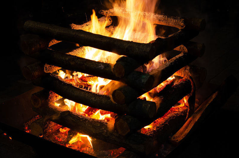 High angle view of bonfire on barbecue grill