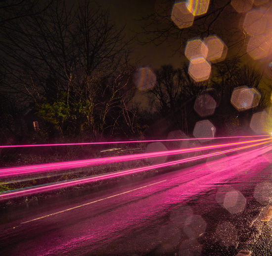 A wet rainy pink highway. Highway Road Street Photography Landscapes Landscape_photography Speed Pink Pink Color Pinklights Slow Shutter Slowshutter Slow Motion Colour Of Life Color Colours Longexposurephotography Long Exposure Longexposure Longexposureoftheday Longexpo Night Light Trail Red Long Exposure Outdoors