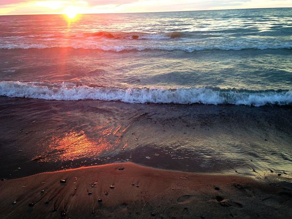 Sea Beach Sunset Wave Nature Sunlight Outdoors Beauty In Nature Sand Horizon Over Water Sun Water No People Lava Day Sunset #sun #clouds #skylovers #sky #nature #beautifulinnature #naturalbeauty #photography #landscape Lake Lakeshore Lake View Lake Huron, Canada Water Reflections