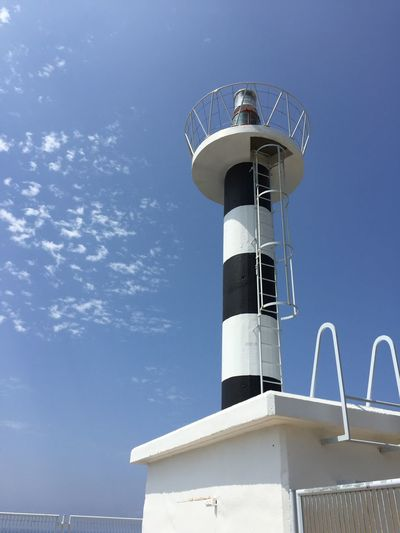 Tower Tall - High Built Structure Radar Business Finance And Industry Building Exterior Lighthouse Blue Water Direction Security System Technology Scenics Architecture No People Lookout Tower Sky Day Nautical Vessel Clear Sky