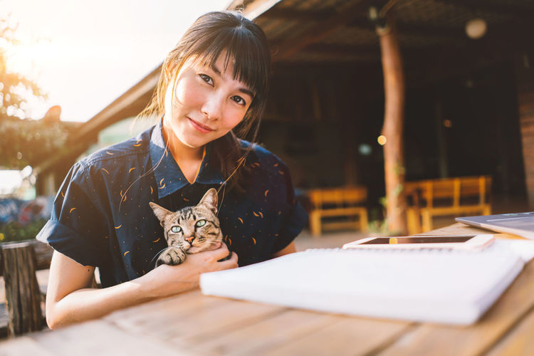 Girl and cat. Happiness Happy Jidpipat_Photo Working Asian Girl Bangs Beautiful Woman Book Casual Clothing Cat Lovers Education Front View Girl Hairstyle Lifestyles Looking At Camera One Person Portrait Publication Real People Selective Focus Smiling Teenager Women Young Adult