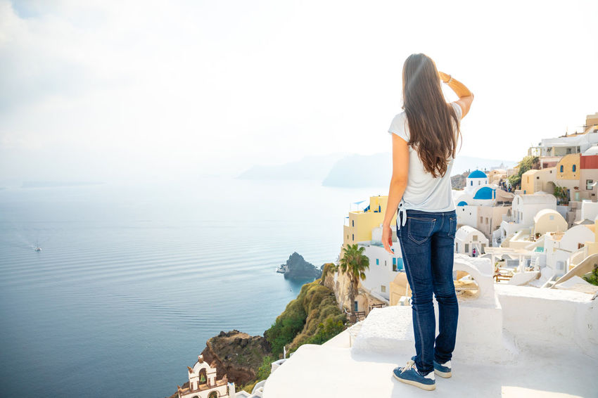 Greece Santorini Oia Thira One Person Water Rear View Lifestyles Leisure Activity Casual Clothing Full Length Real People Beauty In Nature Hairstyle Standing Women Long Hair Hair Nature Adult Sea Day Outdoors Looking At View