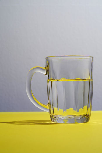 Close-up of yellow glass against white background