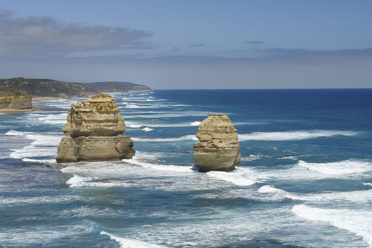 Part of the Twelve Apostles in Australia Adelaide, South Australia Australia Australian Landscape Cliffs Great Ocean Road Twelve Apostles Vacations Australia & Travel Beach Beauty In Nature Blue Sky Blue Water Coast Horizon Horizon Over Water Most Beautiful Place On Earth❤ No People Outdoors Pacific Ocean Rock Formation Sand & Sea Sand Formation Scenics - Nature Tranquil Scene Waves, Ocean, Nature