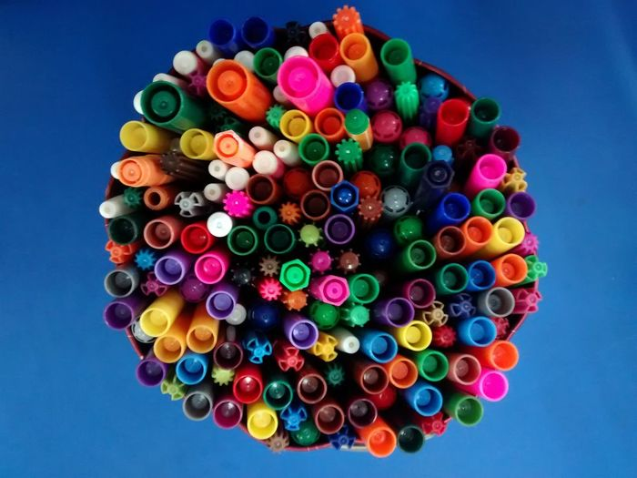 Close-Up Of Colorful Pens On Table