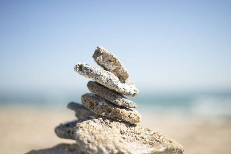 A pyramid of stones on the seashore. cobblestone tower. philosophical themes
