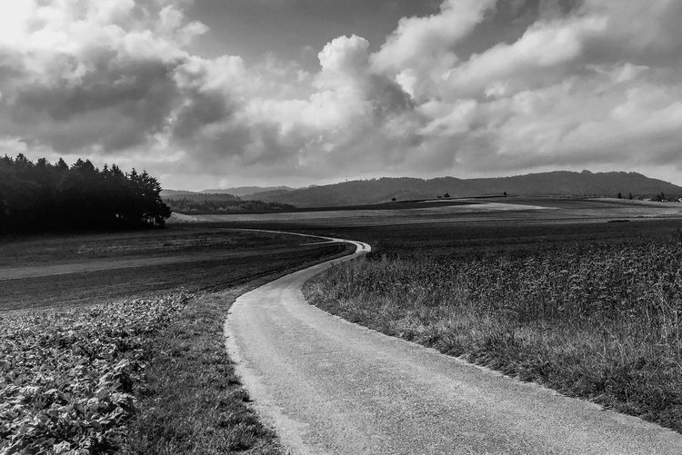 Longandwindingroad Cloud - Sky Sky Land Tranquility Scenics - Nature Tranquil Scene Nature Landscape No People Outdoors Field