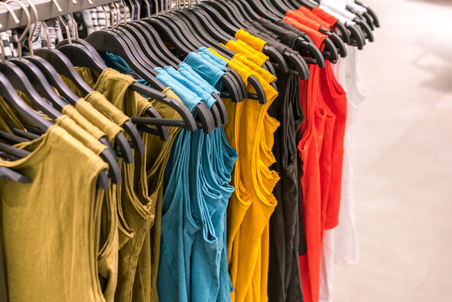 colorful women shirt in clothes rack Arrangement Boutique Business Choice Close-up Clothing Clothing Store Coathanger Collection Day Fashion For Sale Hanging In A Row Indoors  Large Group Of Objects Multi Colored No People Rack Retail  Store Textile Textile Industry Variation