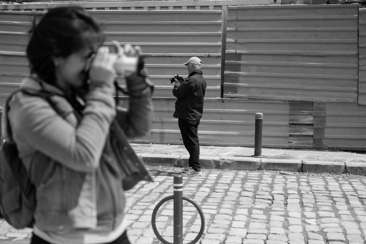 The Street Photographer - 2017 EyeEm Awards Capture The Moment Fujifilm_xseries Acros100 Streetphotography Candid Photography Blackandwhite Adult Adults Only People City Outdoors Men Women Young Adult Day Lifestyles Photography EyeEm Selects The Street Photographer - 2018 EyeEm Awards