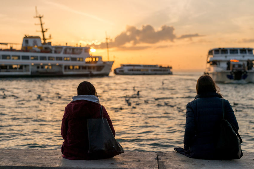 Watching Ferries go By Ferry Istanbul Relaxing Beauty In Nature Bosphorus Friendship Kadıköy Leisure Activity Nature Nautical Vessel Outdoors People Real People Rear View Sea Sitting Sky Sunset Togetherness Two People Urban People Women