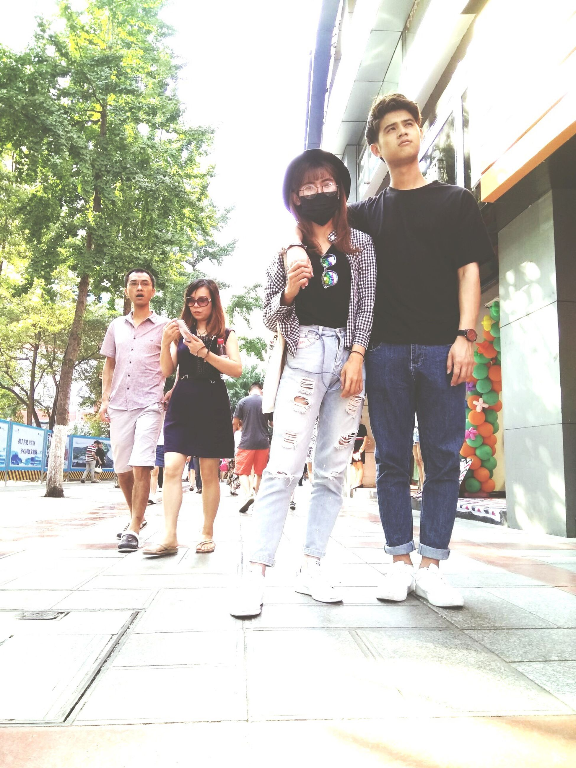 togetherness, love, bonding, lifestyles, leisure activity, young adult, casual clothing, full length, tree, person, young men, happiness, standing, friendship, front view, day, family, looking at camera, well-dressed, outdoors, handsome