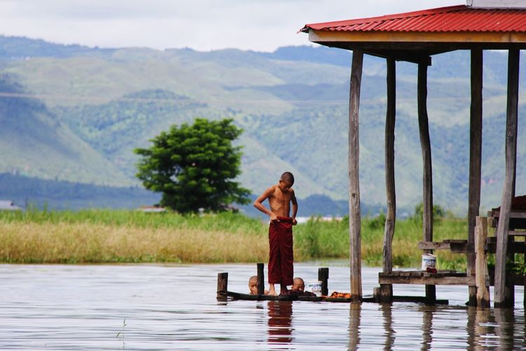 Water Lake Mountain People Nature Outdoors Standing Day Tree Sky Beauty Rural Scene Real People Children Only Childhood Portrait Standing Myanmar Novicephotography Novices... Novice Monks