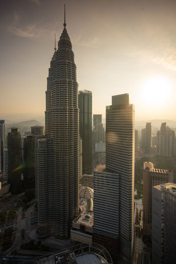 Kuala Lumpur skyline sunrise Building Exterior Built Structure Architecture Building Office Building Exterior City Sky Skyscraper Cityscape Tower Tall - High Travel Destinations Modern No People Office Nature Landscape Travel Outdoors Spire  Financial District