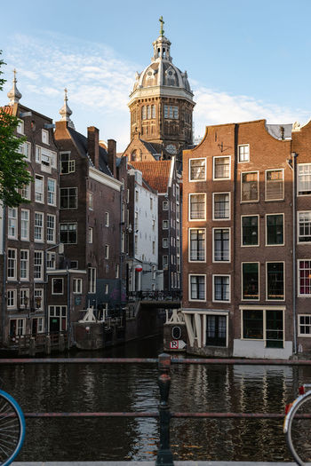 Historical buildings of amsterdam in the sunset light.