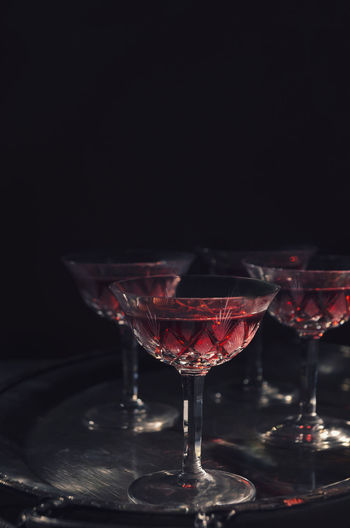 Cherry liqueur in vintage crystal glasses over dark background Still Life Martini Glass Cocktail Red Wine Wineglass Alcohol Drink Martini Black Background Vintage Liqueur Crystal Nightlife Clubbing Menu Artistic Retro GIN Vodka Aperitif Red Restaurant Glass Red Wine
