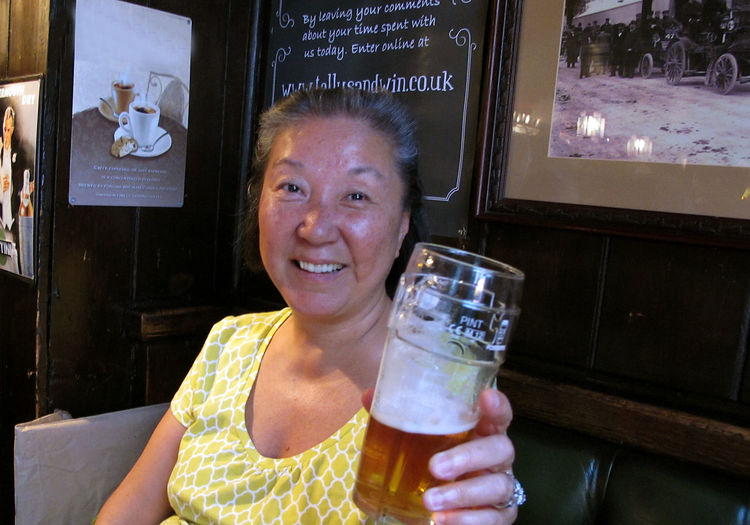 In the pub Asian Woman British Pub Korean Woman Pint Of Lager Casual Clothing Day Drink Front View Happiness Leisure Activity Lifestyles Looking At Camera Mature Asian Woman Mature Woman,senior Woman One Person Portrait Real People Smiling Woman Drinking Woman In A Pub