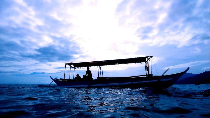 snorkeling in Laiya Beach EyeEmNewHere Philippines Snorkling Nautical Vessel Cloud - Sky Transportation Nature Sea Water Beach Floating On Water Silhouette UnderSea One Person Adult