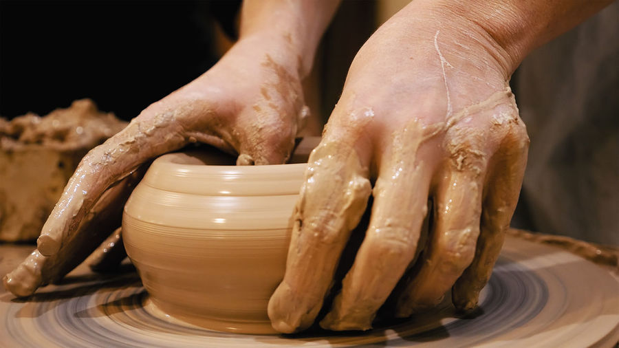 Close-Up Of Person Making Pottery
