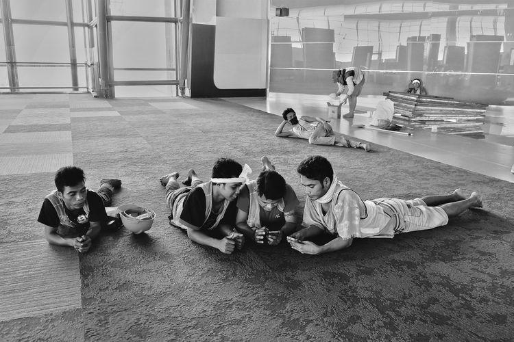 People sitting on floor
