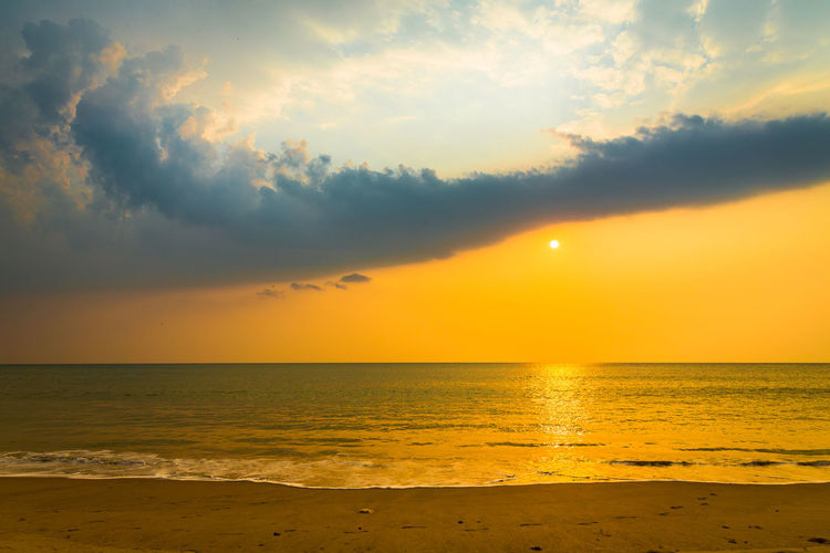 Beach Beauty In Nature Cloud - Sky Day Horizon Over Water Idyllic Nature No People Outdoors Sand Scenics Sea Sky Sun Sunset Tranquil Scene Tranquility Water Yellow