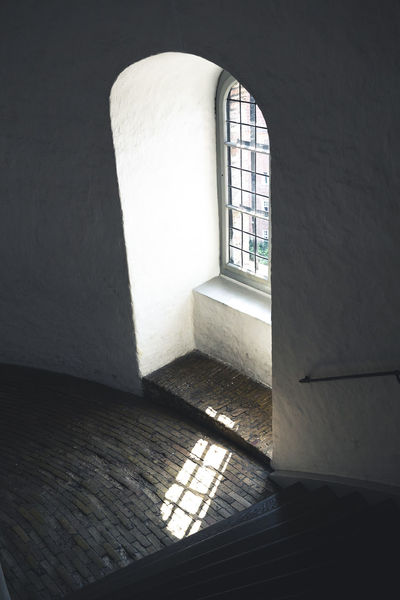 Copenhagen, Denmark Roundtower Absence Arch Architecture Building Built Structure Copenhagen Day Empty Grate Indoors  Nature No People Old Pattern Rundetaarn Shadow Sunlight The Past Wall Wall - Building Feature Window