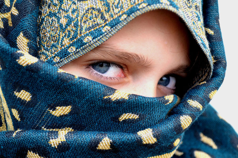 Blue Eyes Body Part Child Childhood Close-up Clothing Covering Eye Front View Girl Headshot Human Body Part Human Face Innocence Looking At Camera Niqab Obscured Face One Person Portrait Real People Scarf Textile Warm Clothing