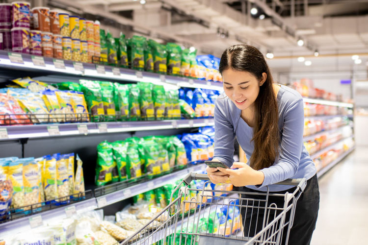 Young woman shopping at grocery store