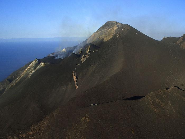 Stromboli volcano by sea against sky