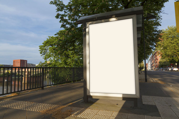 Blank billboard in a bus stop Advertising City Promotion Advertisement Architecture Billboard Blank Blanket Built Structure Bus Stop City Day Footpath Mock Up Nature Outdoor Outdoors Road Sidewalk Street Streetphotography Tree Urban