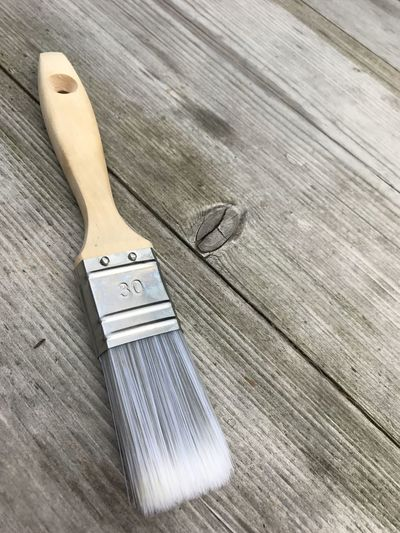 High angle view of paintbrush on wooden table