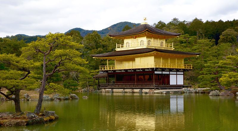 Traveling Travel Kyoto Kyoto, Japan Kyoto,japan Japan Nippon Kinkakuji Temple Kinkakuji Kinkakuji Temple Of Japan Kinkakuji , or Golden Pavilion temple, is the popular use of the name of a famous Buddhist temple , Rokuonji , Kyoto. The pavilion is covered in gold leaf . The building was originally built in 1397, but was burned down by a mentally disturbed monk in 1950. The current building was erected in 1955. Kinkakuji is part of the historic Kyoto which is included on the World Heritage List