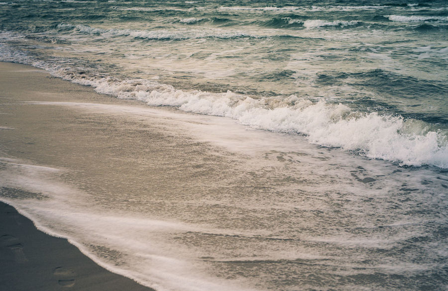 close up of a beach and the sea The Week On EyeEm Beach Beauty In Nature Day Daylight Motion Nature No People Outdoors Power In Nature Sand Sea Shore Tide Water Wave