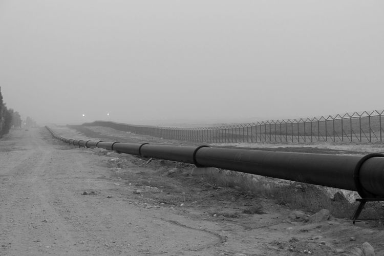 Arabian Bw_collection Bw_lover Desert Gas Long Middle East Nature Oilpipe Outdoors Pipe Pipeline Remote Place The Great Outdoors - 2016 EyeEm Awards The Photojournalist - 2016 EyeEm Awards The Storyteller - 2016 Eyeem Awards Fine Art Photography Monochrome Photography