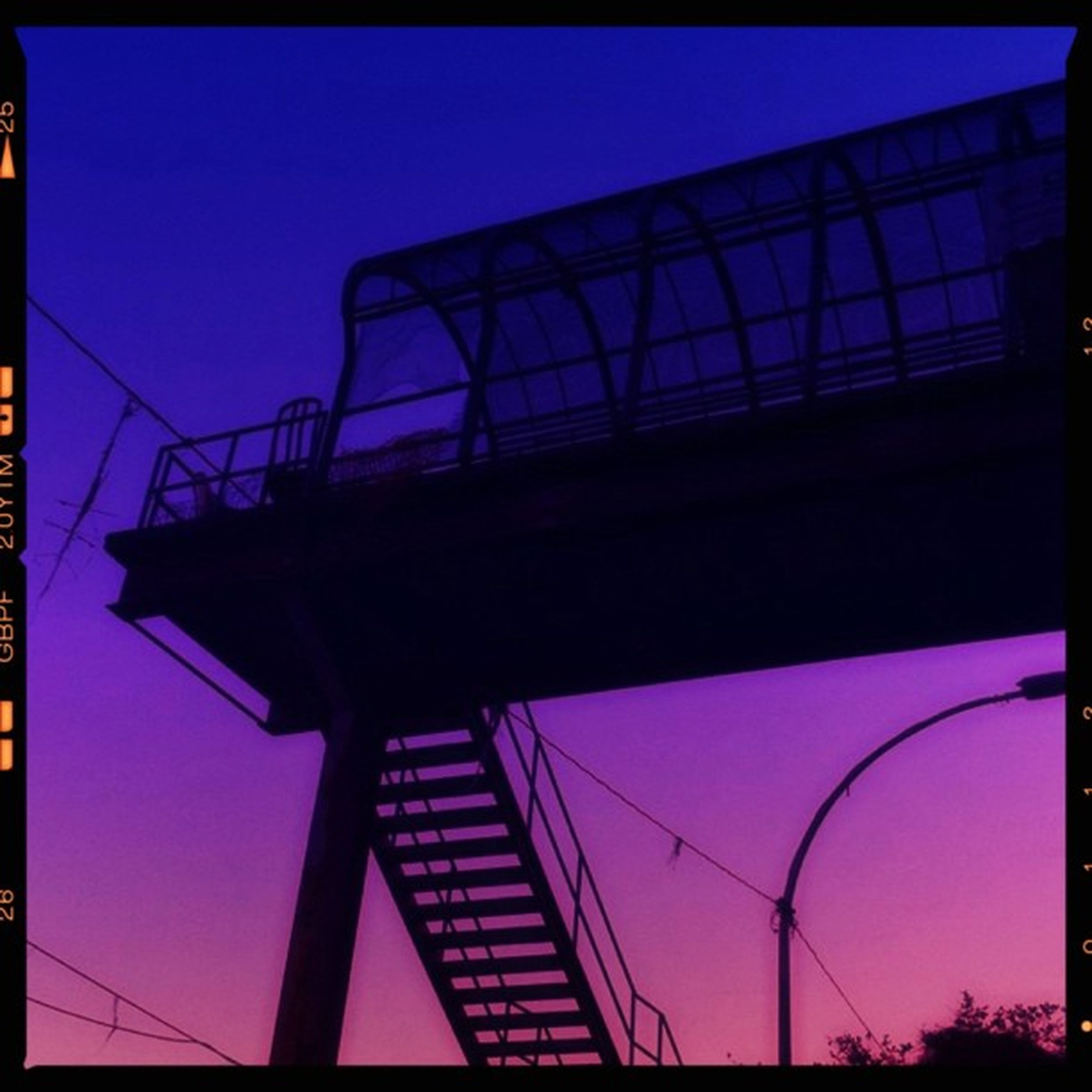 transfer print, low angle view, built structure, auto post production filter, architecture, blue, sky, building exterior, clear sky, silhouette, connection, outdoors, dusk, no people, illuminated, city, metal, day, building