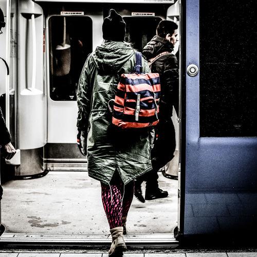 Rear view of man walking in train