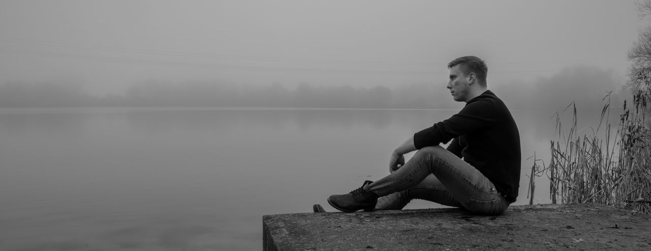 Nature Nebel Wilhelmshaven Blackandwhite Day Fog Full Length Lake Male Nature One Person Outdoors People Real People Saschabarczyk Sitting Sky Water Young Adult Young Men Shades Of Winter