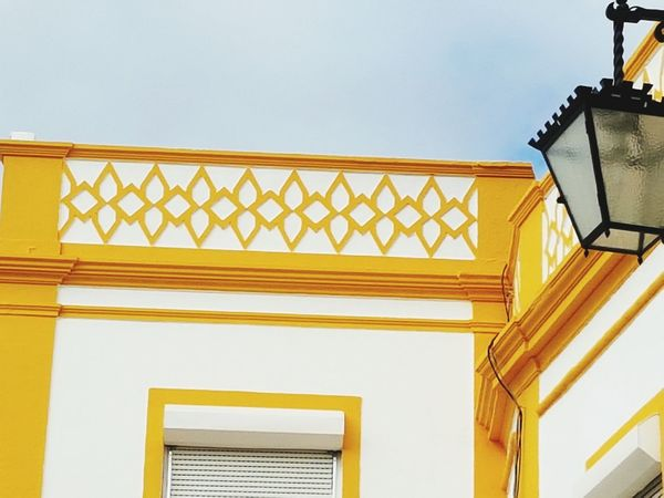 traces of portugal EyeEm Selects Architecture Built Structure Low Angle View Yellow Building Exterior No People Wood - Material Spiral Staircase Sky Day Outdoors