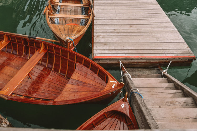 High angle view of boats moored by pier over lake