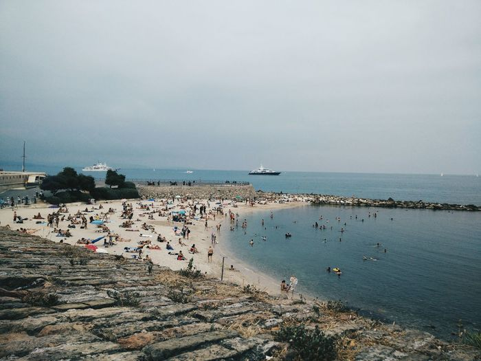 High angle view of people on beach against sky