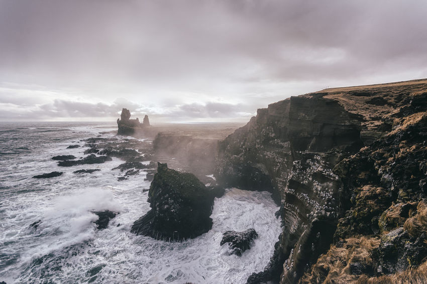 Landscape in Iceland Beauty In Nature Cliff Cloud Cloud - Sky Cloudy Coastline Day Horizon Over Water Idyllic Nature Non-urban Scene Outdoors Remote Rock Rock - Object Rock Formation Scenics Sea Shore Sky Tranquil Scene Tranquility Water Wave Weather